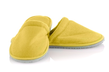 foot gear: A pair of yellow slippers on a white background