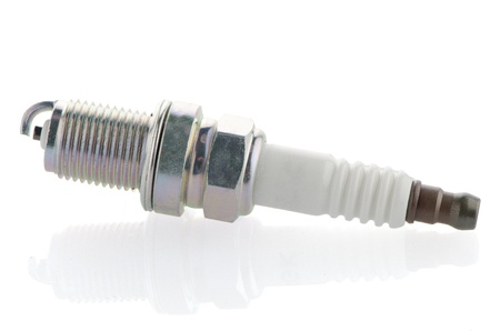 Spark-plug on white reflective background photo