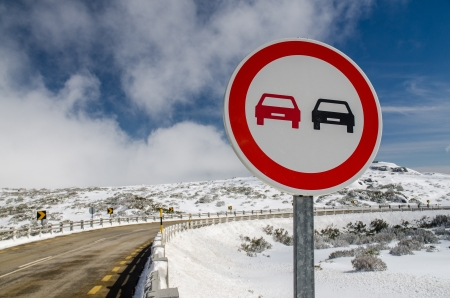 overtake: Overtake Forbidden Sign in a Snowy Road