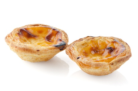 Pasteis de nata, typical pastry from Lisbon - Portugal, isolated on white background. Stock Photo - 18455302