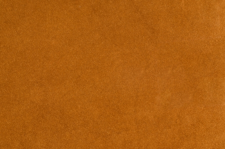 Brown suede closeup background. photo