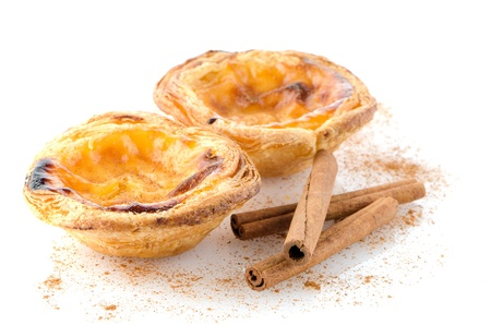 Pasteis de nata, typical pastry from Lisbon - Portugal, isolated on white background. Banco de Imagens