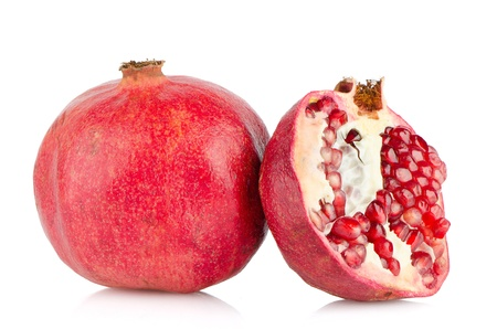 Ripe pomegranate fruit with half isolated on white background. photo