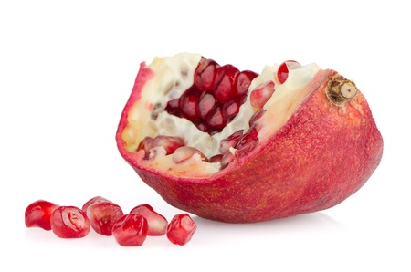 Broken half pomegranate fruit on white background photo