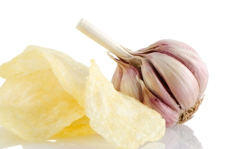 Potato chips and garlic isolated on white background. photo