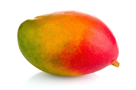Mango fruit on white reflective background.