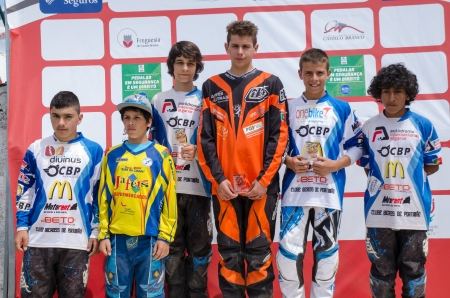 CASTELO BRANCO, PORTUGAL - MAY 5: Juvenis podium at the 3rd stage of the Luso-Spanish BMX race Trophy the  on may 5, 2013 in Castelo Branco, Portugal. Stock Photo - 19416328
