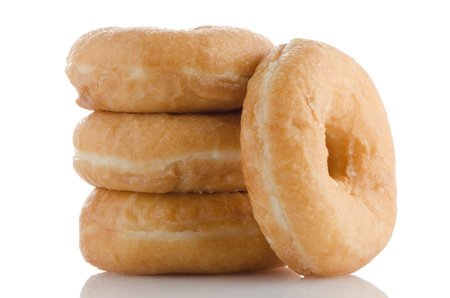 Donuts on a white reflective background. photo