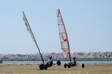 ILHAVO, PORTUGAL - MAY 12: F. Costa and J. Goncalves on two windcars during the Festival do Vento  on may 12, 2013 in Ilhavo, Portugal.