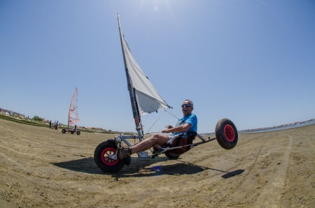ILHAVO, PORTUGAL - MAY 12: Francisco Costa on a landing kite during the Festival do Vento  on may 12, 2013 in Ilhavo, Portugal.