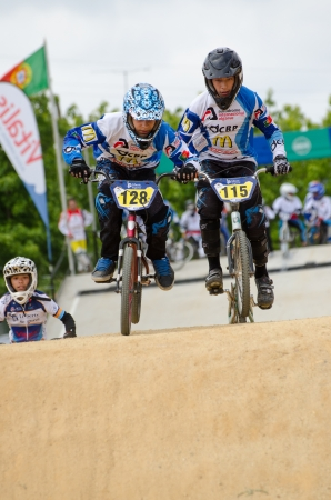off road biking: ESTARREJA, PORTUGAL - MAY 26: Marco Albano on the left, leading the race at the 2nd Portugal Bmx Open on may 26, 2013 in Estarreja, Portugal.