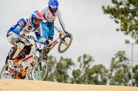 off road biking: ESTARREJA, PORTUGAL - MAY 26: Carlos Rosado, on the left, leading the race at the 2nd Portugal Bmx Open on may 26, 2013 in Estarreja, Portugal.