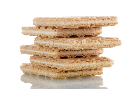 Vanilla wafers on white reflective background. photo