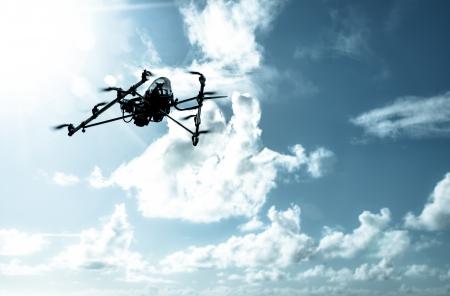 Octarotor drone flying in on a dramatic cloudy sky. Фото со стока - 20015674
