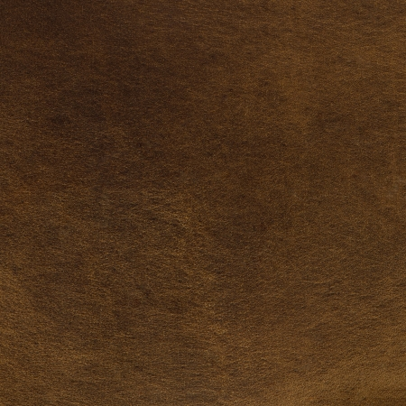 chamois leather: Brown suede closeup background. Stock Photo