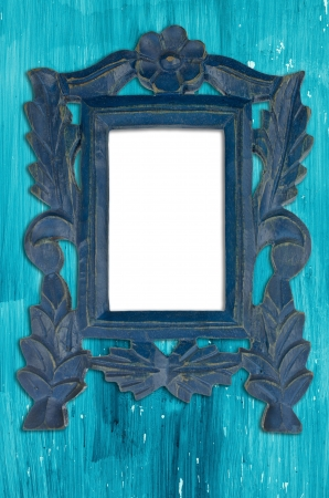 Ornamental blue frame on an aged wooden background. photo