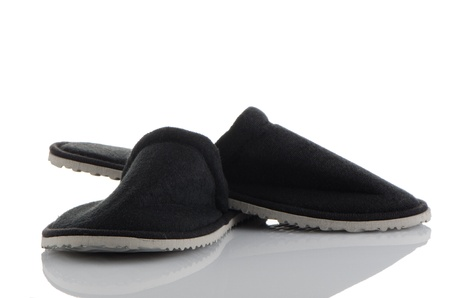 A pair of grey slippers on a white background. photo