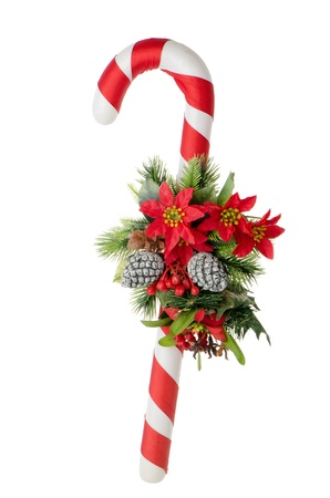 Christmas cane with floral arrangement isolated on white background. photo
