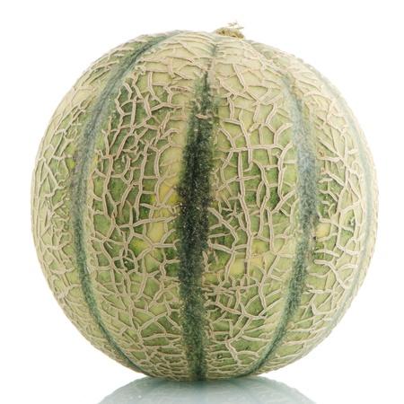 Ripe cantaloupe melon on white reflective background. Stock Photo