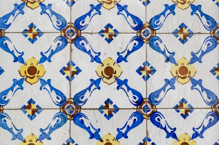Old typical portuguese tiles called azulejos taken from the external walls of an old house in Lisbon photo