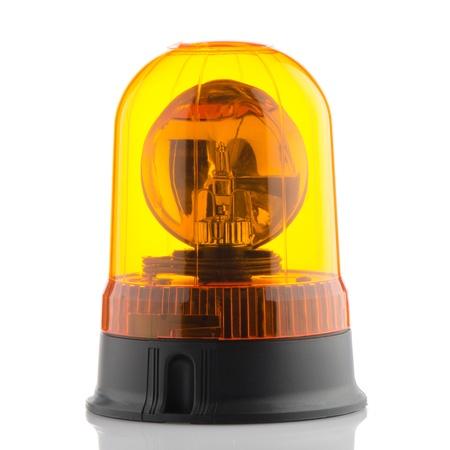 medical attention: Naranja baliza giratoria sobre fondo blanco reflectante. Foto de archivo