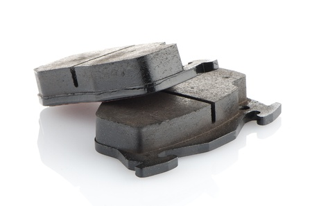Car brake pads on white reflective background. photo