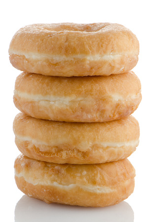 baked treat: Donuts on a white reflective background. Stock Photo
