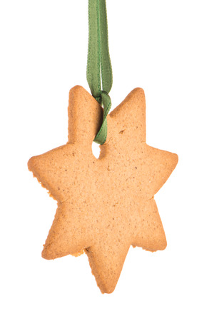 Gingerbread star tied with a green ribbon
