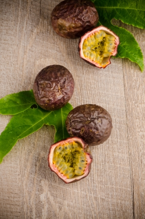 Passion fruits on wooden background photo
