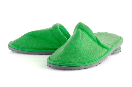 houseshoe: A pair of green slippers on a white background.