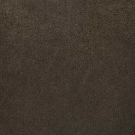 Brown suede closeup background. Stock Photo