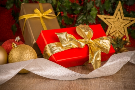 Gift box with christmas elements on wooden background photo