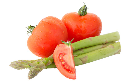 Composition of: tomato and asparagus Isolated on white background. photo