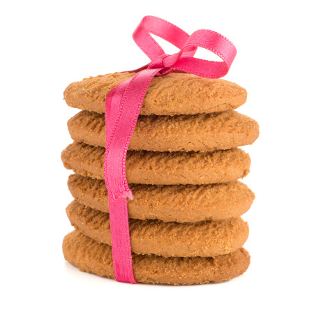 Festive wrapped biscuits pile isolated on a white background photo