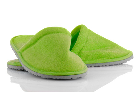 houseshoe: A pair of green slippers on a white.