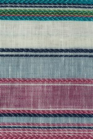 Closeup detail of multi color fabric texture. photo