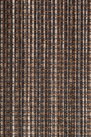 fibrous: Closeup detail of brown fabric texture background.