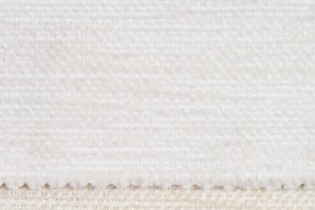 fibrous: Closeup detail of white fabric texture background.