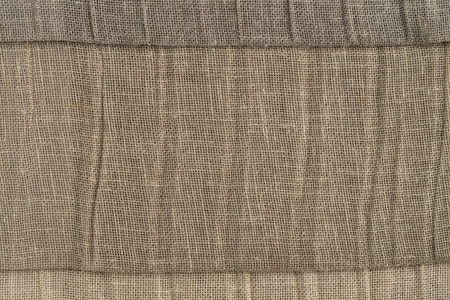 fibra: Closeup detail of brown fabric texture background.