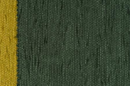 fibrous: Closeup detail of green fabric texture background.