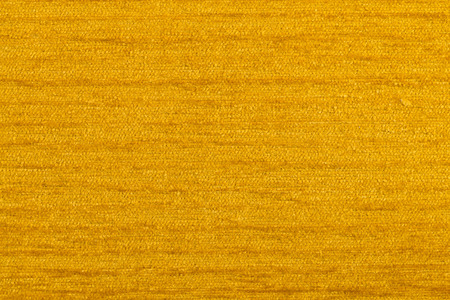 fibrous: Closeup detail of yellow fabric texture background.