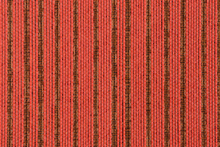 Closeup detail of Red striped fabric texture background. photo