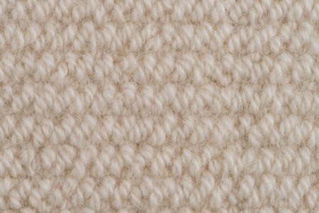 Closeup detail of beige carpet texture . photo