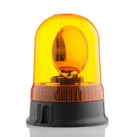 Orange rotating beacon on white reflective background. photo