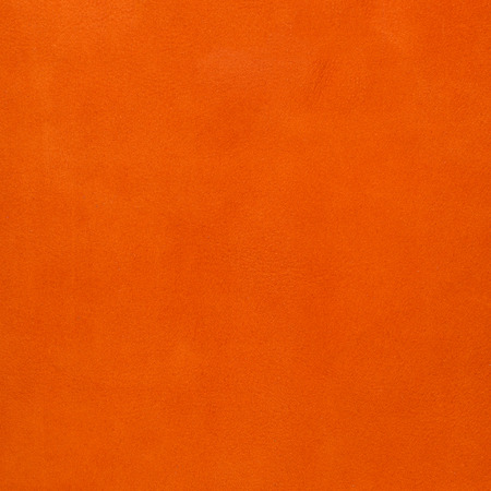 background pattern: Orange leather texture closeup background. Stock Photo