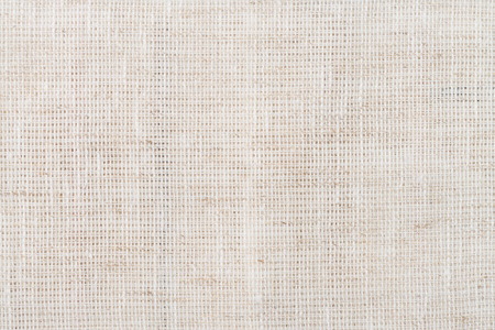 Closeup detail of beige fabric texture background. Banco de Imagens