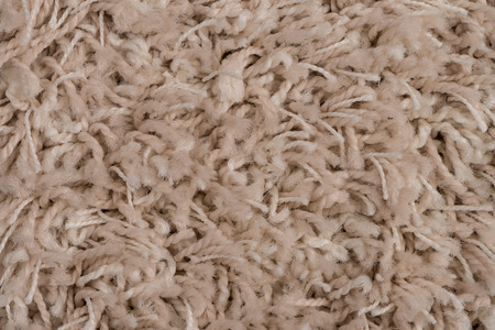 Closeup detail of beige carpet texture background. photo