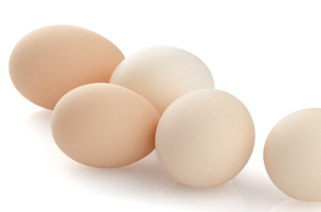 Five eggs isolated on white background. photo