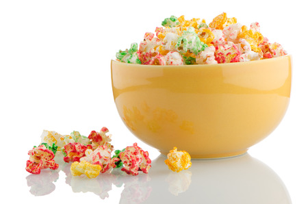 Bowl of popcorn on white reflective background. photo