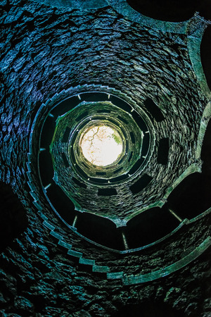 quinta: View of the Masonic initiation well in Quinta da Regaleira, Sintra, Portugal.